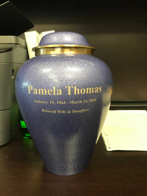 Engraving on Purple Urn