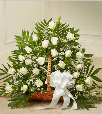 funeral flowers in white basket