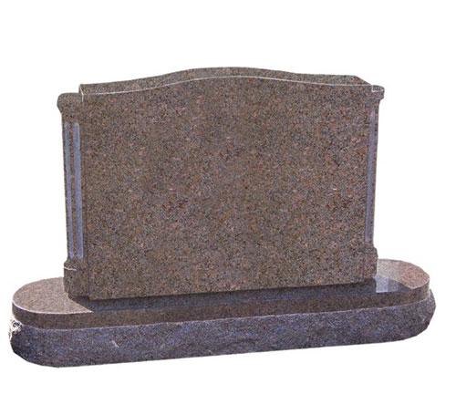 Mahogany granite serpentine headstone